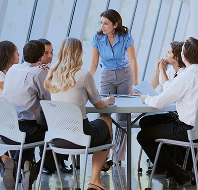 Professional woman discussing career development opportunities with her employees.