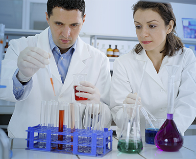 Professional man and woman working in a lab